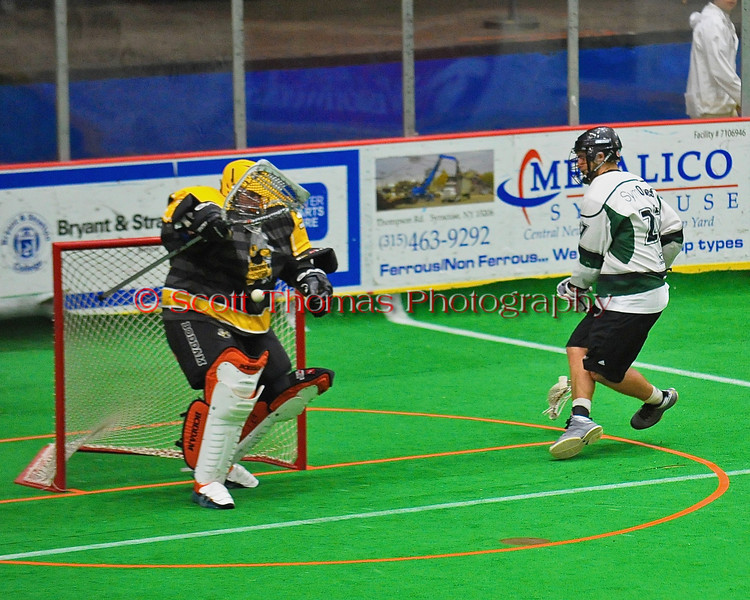 Syracuse Stingers goalie Matt Ural (30) makes a save on Vermont Voyageurs Kurt Hunziker (27) in Professional Box Lacrosse at the War Memorial Arena in Syracuse, New York on Sunday, April 13, 2014. Vermont won 19-12.