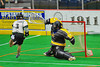 Vermont Voyageurs Brandon Dube (3) scores on Syracuse Stingers goalie Matt Ural (30) in Professional Box Lacrosse at the War Memorial Arena in Syracuse, New York on Sunday, April 13, 2014. Vermont won 19-12.