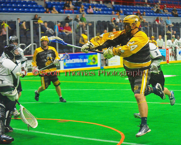 Syracuse Stingers Alex Cook (24) shoots and scores on the  Vermont Voyageurs in Professional Box Lacrosse at the War Memorial Arena in Syracuse, New York on Sunday, April 13, 2014. Vermont won 19-12.
