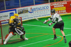 Vermont Voyageurs Ryan Hotalig's (19) jump shot is stopped by Syracuse Stingers goalie Matt Ural (30) in Professional Box Lacrosse at the War Memorial Arena in Syracuse, New York on Sunday, April 13, 2014. Vermont won 19-12.