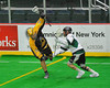 Syracuse Stingers Jason Ostune (42) avoids a Vermont Voyageurs defenders in Professional Box Lacrosse at the War Memorial Arena in Syracuse, New York on Sunday, April 13, 2014. Vermont won 19-12.