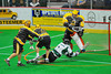 Vermont Voyageurs Ethan Farrell (4) scores on Syracuse Stingers goalie Matt Ural (30) in Professional Box Lacrosse at the War Memorial Arena in Syracuse, New York on Sunday, April 13, 2014. Vermont won 19-12.