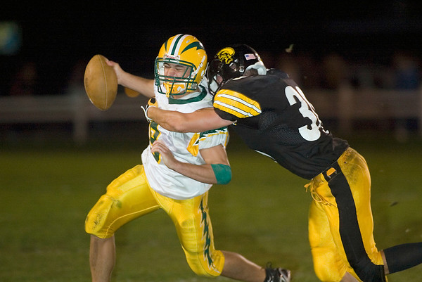 Record-Eagle/Jan-Michael Stump<br /> Midland Dow quarterback Brandon Sklenar (9) gets tackled by Traverse City Central's Dylan Roe (30) in the fourth quarter of Friday's game.