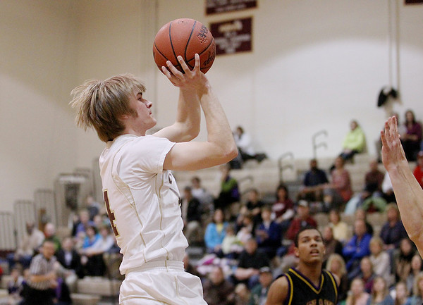 Record-Eagle/Keith King<br /> Traverse City Christian's Ian Newberry shoots the ball against Leland Monday, February 13, 2012 at Traverse City Christian School.