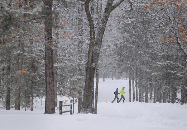 Record-Eagle/Keith King<br /> Runners race through the snow Saturday, April 13, 2013 during the Traverse City Trail Running Festival at Timber Ridge Resort.