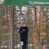 Record-Eagle/Keith King<br /> Kenny Thomas, of Traverse City, crosses the finish line first in the men's division 50k race Saturday, April 13, 2013 during the Traverse City Trail Running Festival at Timber Ridge Resort.