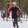 Record-Eagle/Keith King<br /> Kelli VanOoteghem, of Essexville, cross the finish line first in the women's division 50k race Saturday, April 13, 2013 during the Traverse City Trail Running Festival at Timber Ridge Resort.