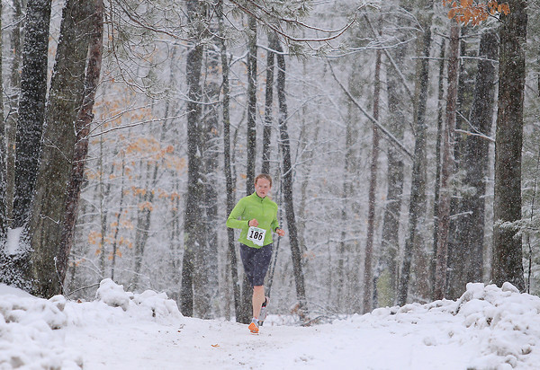 Record-Eagle/Keith King<br /> Jessie Houghton, of Traverse City, runs in the 11k race Saturday, April 13, 2013 during the Traverse City Trail Running Festival at Timber Ridge Resort. Houghton finished first in the women's division of the 11k race.