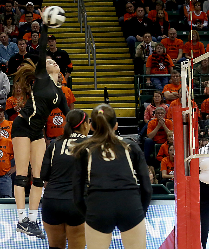 E.L. Hubbard / Special to GateHouse Ohio Media<br /> New Philadelphia Tuscarawas Central Catholic's Alexis Gilland goes high for a kill attempt against Jackson Center during their Division IV State Championship game at Wright State's Nutter Center in Fairborn Saturday, Nov. 12, 2016.