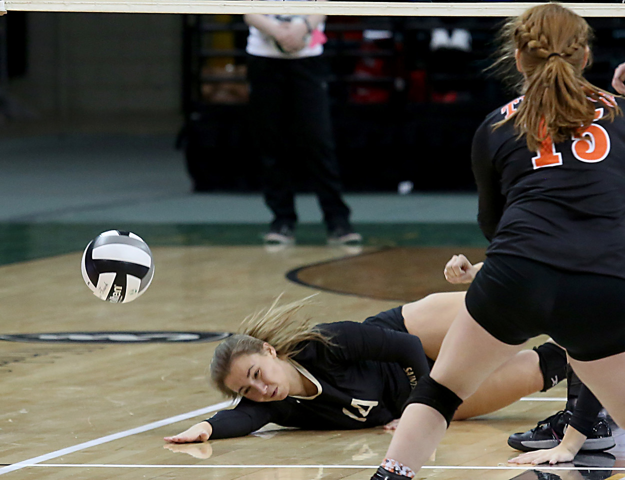E.L. Hubbard / Special to GateHouse Ohio Media<br /> New Philadelphia Tuscarawas Central Catholic's Katie Churilla can't get to a Jackson Center volley during their Division IV State Championship game at Wright State's Nutter Center in Fairborn Saturday, Nov. 12, 2016.