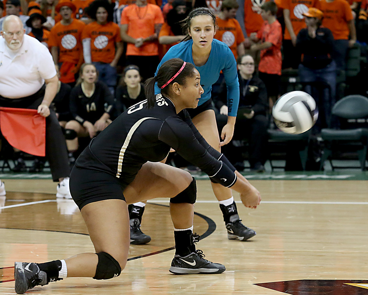 E.L. Hubbard / Special to GateHouse Ohio Media<br /> New Philadelphia Tuscarawas Central Catholic's Maggie Dominick digs out a Jackson Center serve during their Division IV State Championship game at Wright State's Nutter Center in Fairborn Saturday, Nov. 12, 2016.