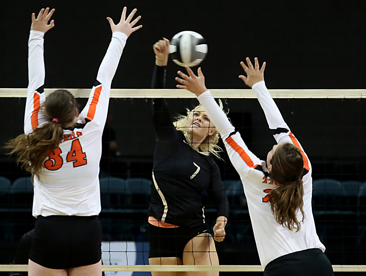 E.L. Hubbard / Special to GateHouse Ohio Media<br /> New Philadelphia Tuscarawas Central Catholic's Abbi Gillson fires a volley between Jackson Center's Alicia Kessler and Camryn Hoehne during their Division IV State Championship game at Wright State's Nutter Center in Fairborn Saturday, Nov. 12, 2016.