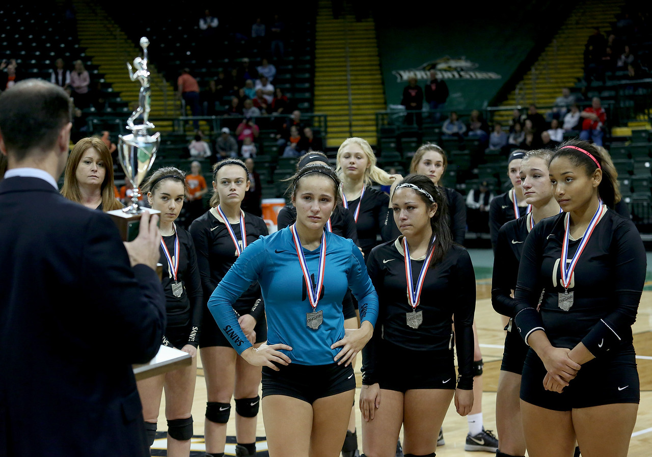 E.L. Hubbard / Special to GateHouse Ohio Media<br /> The New Philadelphia Tuscarawas Central Catholic Saints prepare to accept their second place trophy in Division IV volleyball at Wright State's Nutter Center in Fairborn Saturday, Nov. 12, 2016.