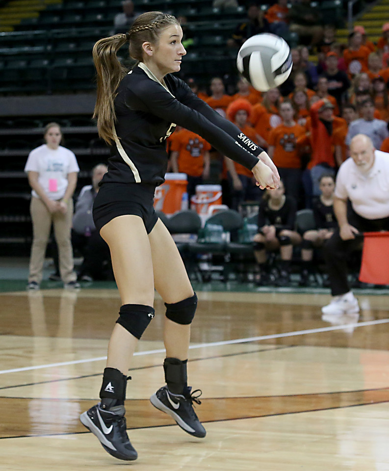E.L. Hubbard / Special to GateHouse Ohio Media<br /> New Philadelphia Tuscarawas Central Catholic's Alyssa Teater returns a volley to Jackson Center during their Division IV State Championship game at Wright State's Nutter Center in Fairborn Saturday, Nov. 12, 2016.