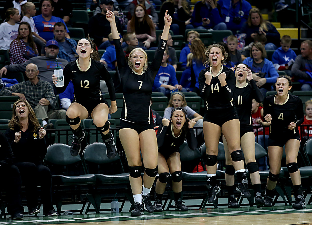 E.L. Hubbard / Special to GateHouse Ohio Media<br /> The New Philadelphia Tuscarawas Central Catholic bench reacts as they score against McComb in their Division IV semifinal at Wright State's Nutter Center in Fairborn Friday, Nov. 11, 2016.