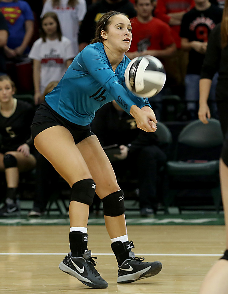 E.L. Hubbard / Special to GateHouse Ohio Media<br /> New Philadelphia Tuscarawas Central Catholic L Brooke Beamer returns a volley to McComb during their Division IV semifinal at Wright State's Nutter Center in Fairborn Friday, Nov. 11, 2016.