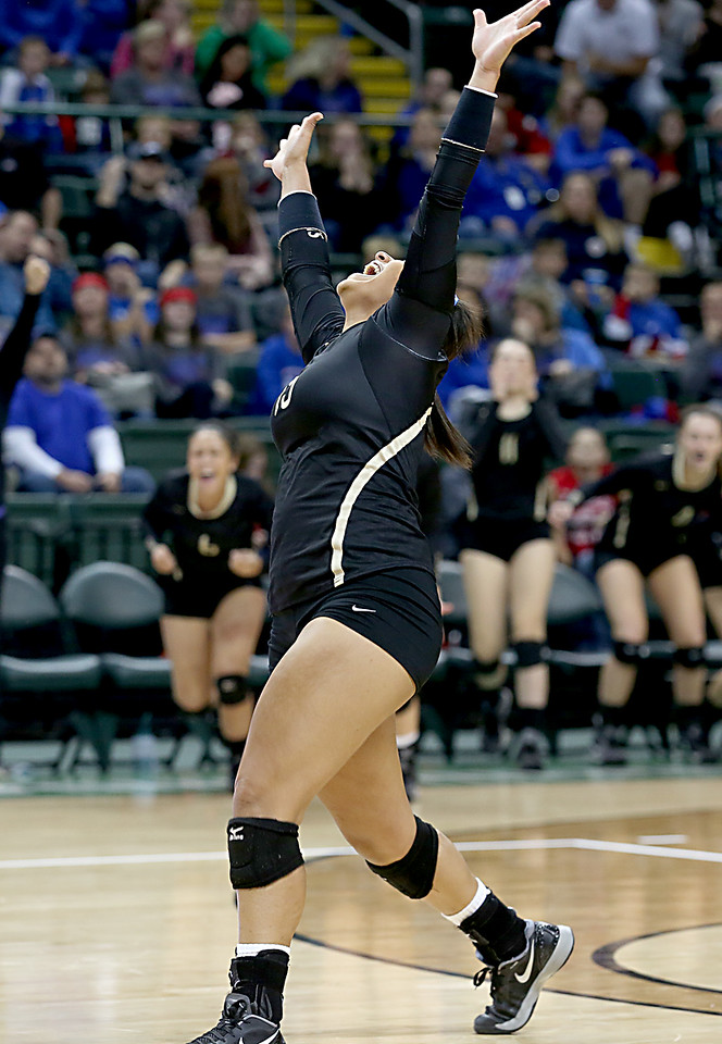 E.L. Hubbard / Special to GateHouse Ohio Media<br /> New Philadelphia Tuscarawas Central Catholic's Maggie Dominick reacts as her team defeats McComb in their Division IV semifinal at Wright State's Nutter Center in Fairborn Friday, Nov. 11, 2016.