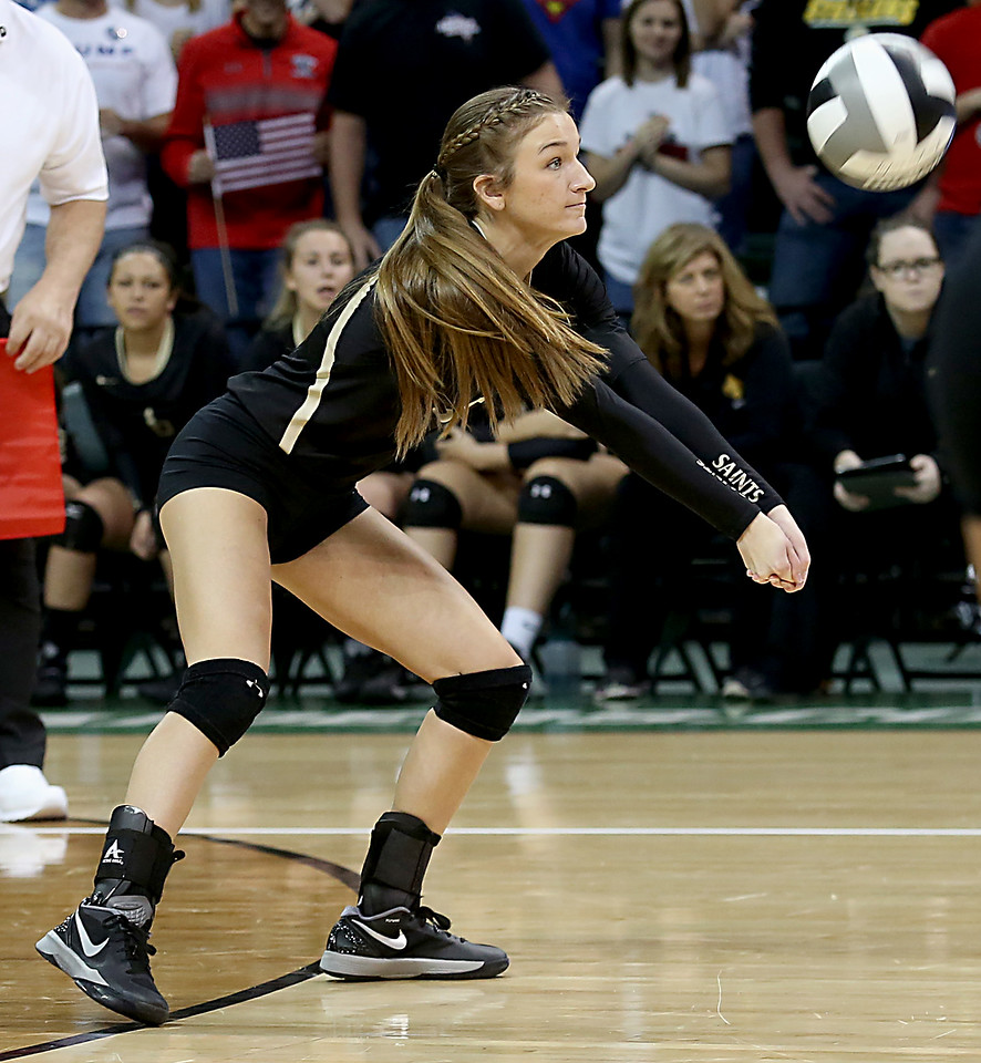 E.L. Hubbard / Special to GateHouse Ohio Media<br /> New Philadelphia Tuscarawas Central Catholic S/RH Reagan Triplett returns a McComb volley during their Division IV semifinal at Wright State's Nutter Center in Fairborn Friday, Nov. 11, 2016.