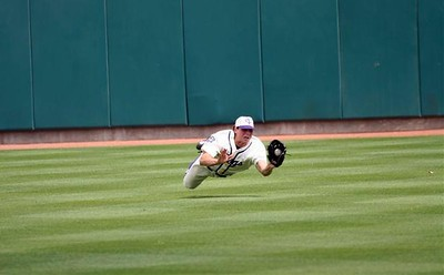 Keith Conlon of TCU makes a diving catch in center field vs Arizona State on 3-12-06.