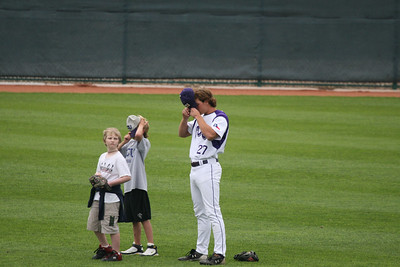 Frogs' centerfielder, Keith Conlon, dons his hat along with Taylor Cragin's younger brother, Garrett, after the playing of the National Anthem on Sunday before the final game of the Air Force series.