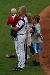 Third baseman, Steven Trout, holds his nephew before the start of Sunday's final game against Air Force.
