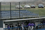 The visitors' side of the bleachers was empty and cold.