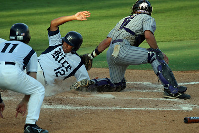 Andrew Walker tags out a Rice base runner on 6-3-07.