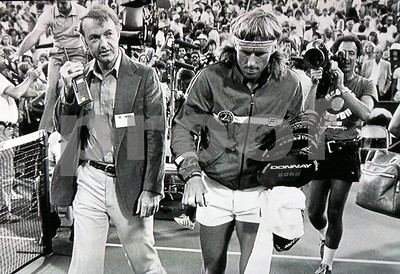 Bjorn Borg walks off centre court after losing to John McEnroe in the 1981 US Open Tennis Championship Final.  Director of Photography Chuck Cohen, to Borg's right, captures the moment on 16mm film.  Chuck shot still photos when not shooting 16mm footage of the match and tournament.