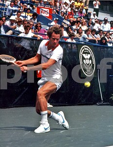 John McEnroe focuses on ball as he prepares to hit his patented backhand shot at the 1981 US Open in Flushing Meadows NY, which he won, beating Bjorn Borg in the final for his 3rd consecutive US Open title.