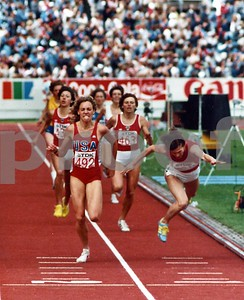 USA's Mary Decker wins the 1,500 meter race at the World Track and Field Championships, Helsinki, Finland 1983, as Zamira Zaytseva, Russia's finest runner lunges at the finish line.