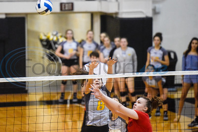 Tyler Junior College's Breeana Gamueda (8) and Trinity Valley Community College's Ana Paula Zandona (12) reach for the ball during a college volleyball game at Tyler Junior College in Tyler, Texas, on Wednesday, Sept. 19, 2018. (Chelsea Purgahn/Tyler Morning Telegraph)