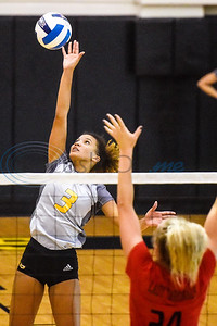 Tyler Junior College's Kariely Santana (3) spikes the ball as Trinity Valley Community College's Lauren Castles (24) jumps to block the ball during a college volleyball game at Tyler Junior College in Tyler, Texas, on Wednesday, Sept. 19, 2018. (Chelsea Purgahn/Tyler Morning Telegraph)
