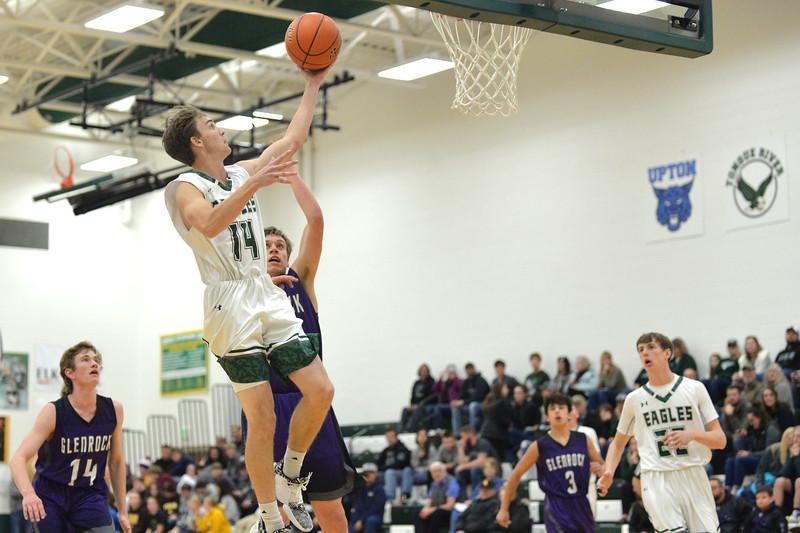 Joel Moline | The Sheridan Press<br /> Tongue River's Nick Summers (14) makes a layup against Glenrock High School Friday, Jan. 10, 2019.