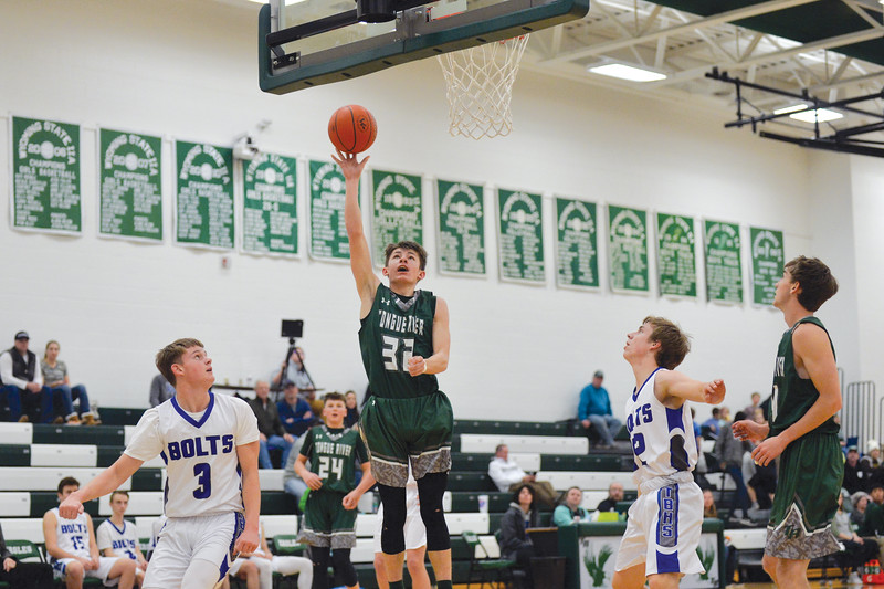 Joel Moline | The Sheridan Press<br /> Tongue River's Eli Cummins (31) scores a layup against Thunder Basin High School junior varsity Saturday,  Jan. 11, 2019.