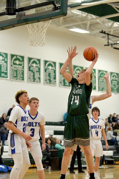 Joel Moline | The Sheridan Press<br /> Tongue River's Sam Patterson (34) scores from close range against Thunder Basin High School JV Saturday, Jan. 11, 2019.