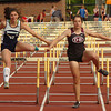 girls 100 meter hurdles at the last hurdle at the Times News Relays. Photo by Ned Jilton II