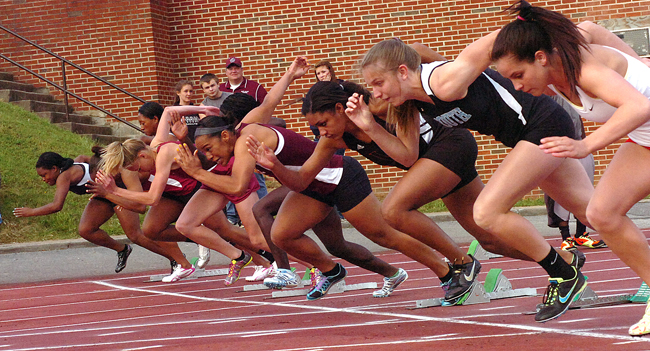 Girls break from the start of the 100 meter dash at the Times News Relays. Photo by Ned Jilton II