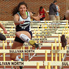 girls 100 meter hurdleswith two of the top finishers crossing hurdle at the sme time at the Times News Relays. Photo by Ned Jilton II