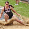 Adriana Walkins lands in the pit during the women's triple jump at the Times News Relays. Photo by Ned Jilton II