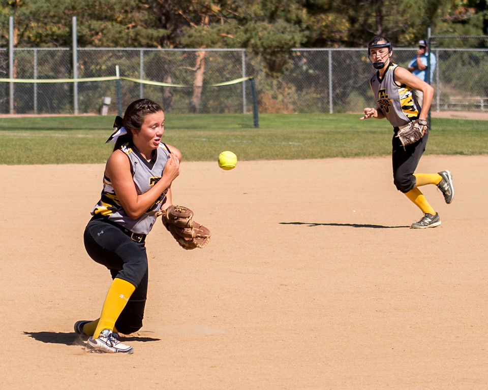 . Thompson Valley shortstop Katie Seja (9) uses her body to knock down a potential hit by Windsor Saturday morning Oct. 1, 2016 at Centennial Park in Loveland. The Eagles came from behind to win, 9-8. (Photo by Michael Brian/Loveland Reporter-Herald)