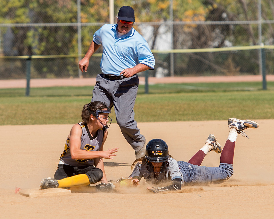 . Thompson Valley\'s Makenna McVay (10) tags Windsor\'s Alyssa LeCroy (9) out at second base Saturday morning Oct. 1, 2016 at Centennial Park in Loveland. Thompson Valley beat the Windsor Wizards, 9-8. (Photo by Michael Brian/Loveland Reporter-Herald)