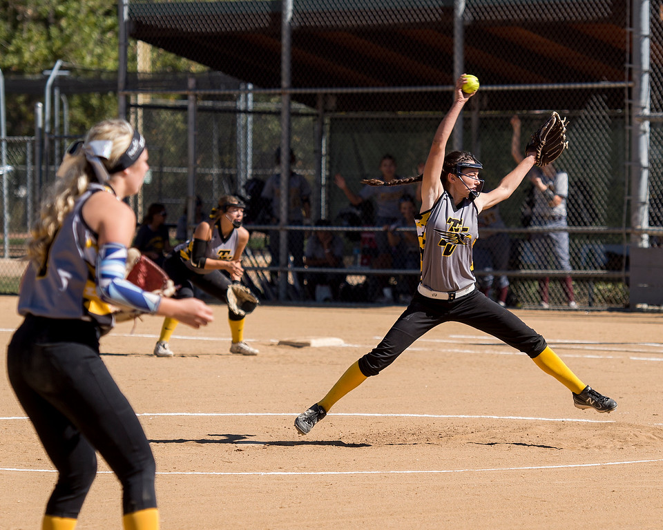 . Thompson Valley\'s Makenna McVay (10) pitches against Windsor Saturday morning Oct. 1, 2016 at Centennial Park in Loveland. The Eagles pulled out a come from behind win over the Wizards, 9-8. (Photo by Michael Brian/Loveland Reporter-Herald)