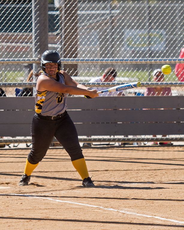 . Thompson Valley junior Cassie Orozco (14) hits against Windsor during early action Saturday morning Oct. 1, 2016 at Centennial Park in Loveland. Orozco would later hit the game-winnning RBI as the Eagles prevailed over the Wizards, 9-8. (Photo by Michael Brian/Loveland Reporter-Herald)