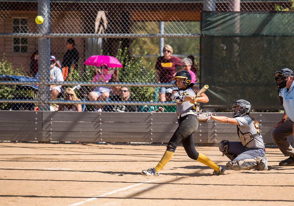 . Thompson Valley catcher Janessa Rivera (3) blasts a shot to the outfield late in the game against Windsor Saturday morning Oct. 1, 2016 at Centennial Park in Loveland. Rivera had a home run earlier in the game to help the Eagles to a 9-8 win. (Photo by Michael Brian/Loveland Reporter-Herald)