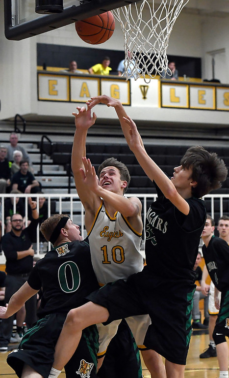 . Thompson Valley\'s #10 Justin Wiersema goes up for a shot as Niwot\'s #0 Adam Barber and #32 Cameron Carlson try to block during their game Thursday, Feb. 9, 2017, at Thompson Valley High School in Loveland.  (Photo By Logan O\'Brien/ Loveland Reporter-Herald)