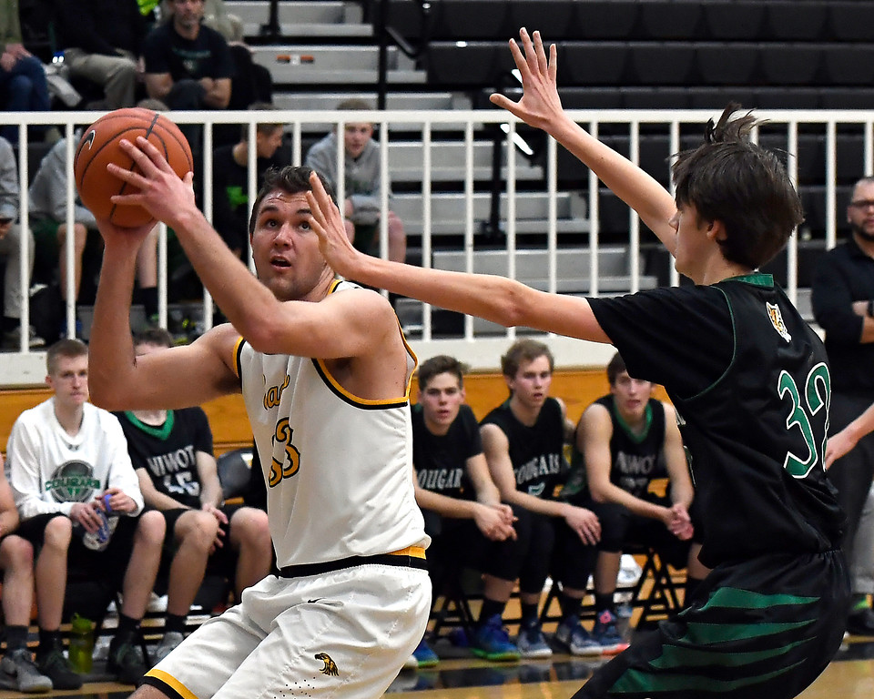 . Thompson Valley\'s #33 Jared Kasprzak looks up for a shot as Niwot\'s #32 Cameron Carlson tries to block during their game Thursday, Feb. 9, 2017, at Thompson Valley High School in Loveland.  (Photo By Logan O\'Brien/ Loveland Reporter-Herald)