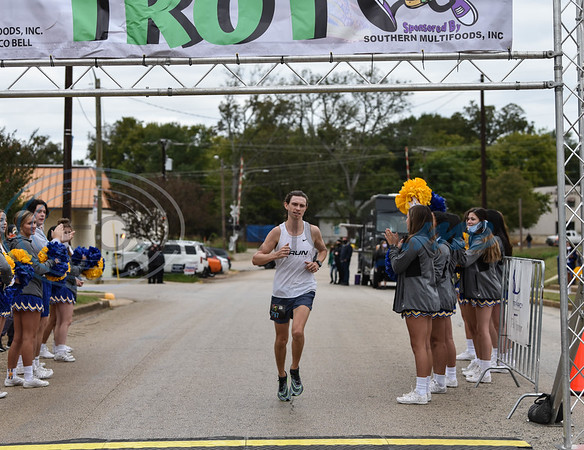 Joshua Jarvis of Tyler is the first runner to make his way across the finish line at the Taco Trot 5K on Saturday. The race took place in downtown Jacksonville in front of the historic Tomato Bowl.