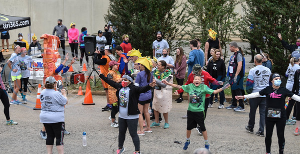 Runners warm up before beginning the Taco Trot on Saturday in downtown Jacksonville.