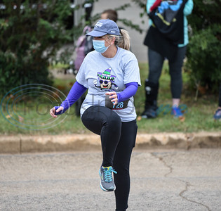 Jamie Maddox of UT Tyler Jacksonville stretches to warm up for the Taco Trot on Saturday. The first-time event benefits the American Cancer Society and was sponsored by Southern Multifoods, Inc., a franchisee of Taco Bell.