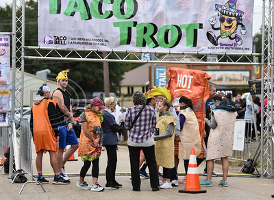 Runners dressed as tacos gather at the start line for the Taco Trot 5K on Saturday. The first-time event benefits the American Cancer Society and was sponsored by Southern Multifoods, Inc., a franchisee of Taco Bell.